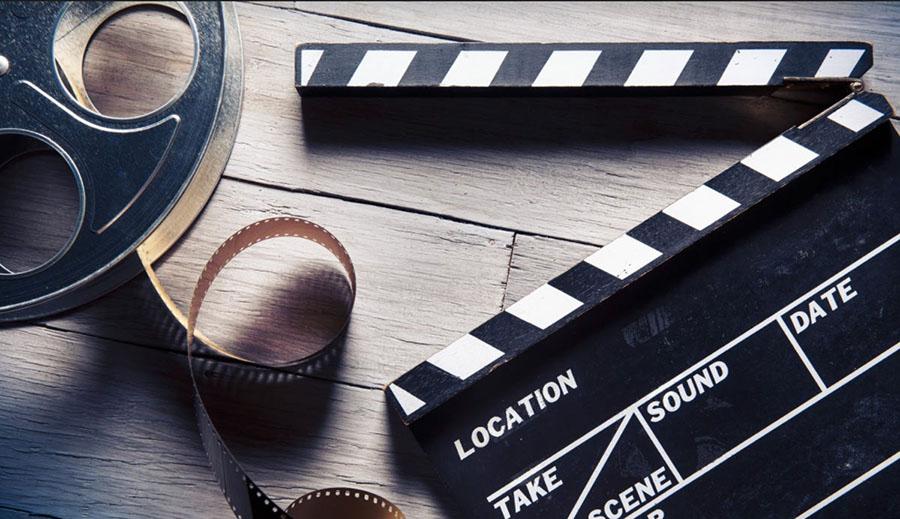 Claquete e rolo de filme